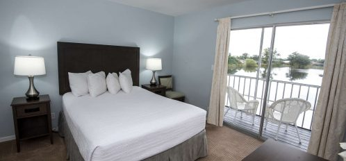 Marco Island Lakeside Inn 1 BR Suite second floor bed balcony lake view