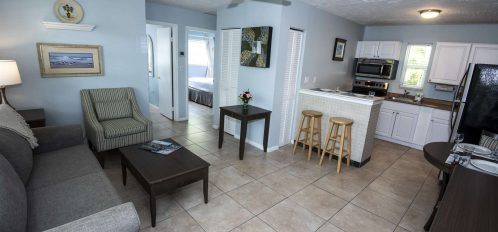 Marco Island Lakeside Inn 2 BR Poolside living dining kitchen hallway from door