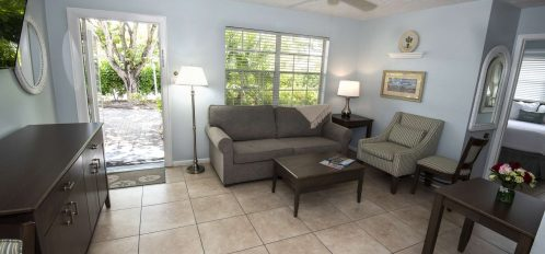 Marco Island Lakeside Inn 2 BR Poolside living room front door from kitchen