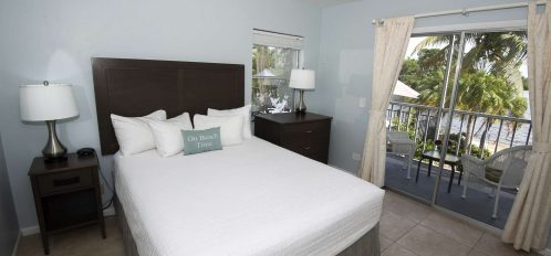 Marco Island Lakeside Inn Lakeview Superior 1BR Suite first floor corner window bed lake view