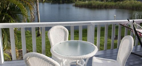 Marco Island Lakeside Inn Lakeview Superior 2 BR-2BA Suite cafe table deck over lake