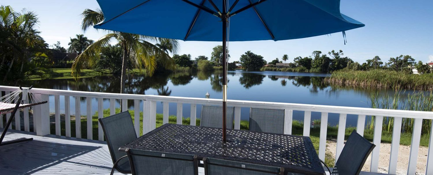 Marco Island Lakeside Inn Lakeview Superior 2 BR-2BA Suite deck table chairs umbrella