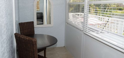 Marco Island Lakeside Inn Lakeview Superior 2 BR-2BA Suite enclosed porch cafe seating