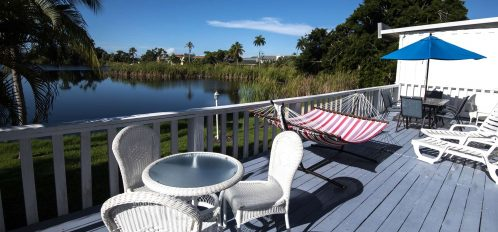 Marco Island Lakeside Inn Lakeview Superior 2 BR-2BA Suite expansive deck hammock table chairs lake view