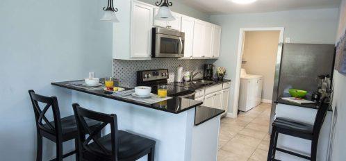 Marco Island Lakeside Inn Standard Villa 2BR-1BA kitchen breakfast bar