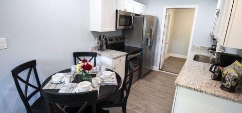 Marco Island Lakeside Inn Villa 2BR-1BA Dining and kitchen