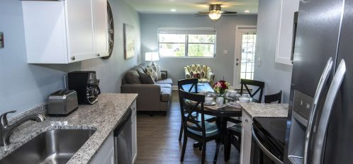 Marco Island Lakeside Inn Villa 2BR-1BA dining and living room from kitchen