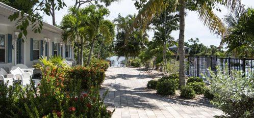 Marco Island Lakeside Inn exterior garden walkway lake pool