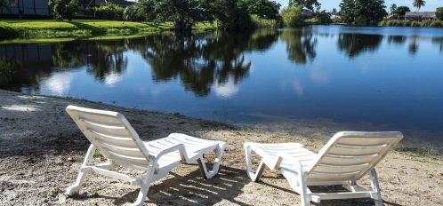 Marco Island Lakeside Inn exterior beach chairs on lake