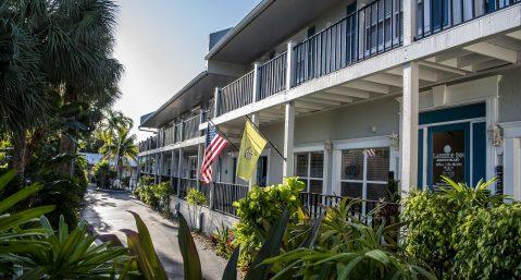 Marco Island Lakeside Inn exterior front lobby door flags