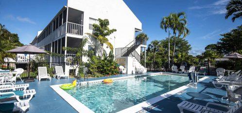 Marco Island Lakeside Inn exterior pool to hotel