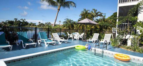 Marco Island Lakeside Inn exterior pool to table and umbrella