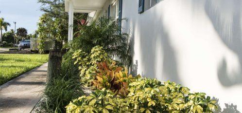 Marco Island Lakeside Inn exterior villa floral closeup vertical